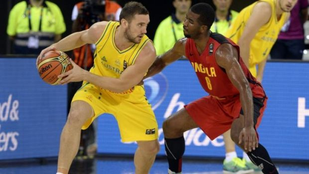 Australia's Chris Goulding vies with Angola's  Roberto Fortes during the match between the two countries on September 4.