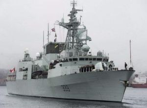 Canada has accused Moscow of sending military aircraft to circle the HMCS Toronto.
