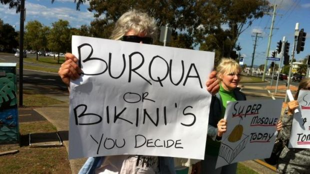 A small group of protesters oppose a proposed mosque in Currumbin.