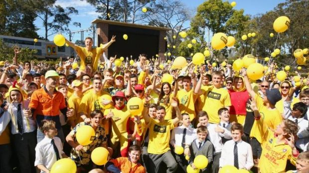 Students pose and release yellow balloons during the Knox Yellow Assembly raising awareness for RUOK? Day at Knox ...
