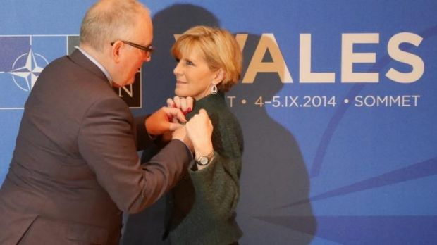 Dutch Foreign Affairs Minister Frans Timmermans pins a medal on Australian Foreign Affairs Minister Julie Bishop at the ...