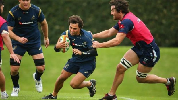 Opportunity ... Cadeyrn Neville, right, tackles Nick Phipps during a Wallabies training session.