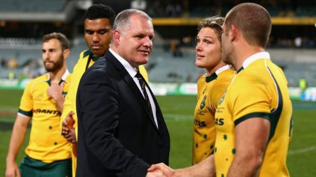 Aiming for accuracy: Ewen McKenzie congratulates Matt Hodgson of the Wallabies.