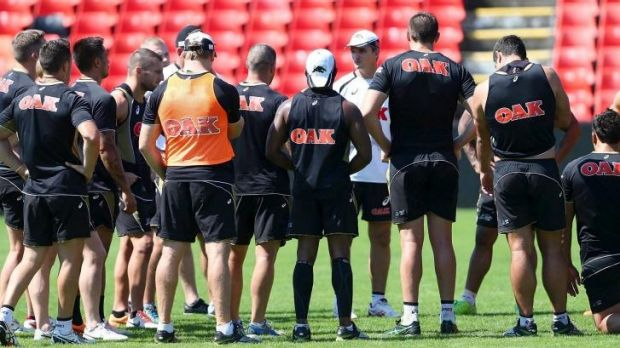 Listen up: Ivan Cleary addresses Panthers players at training on Wednesday.