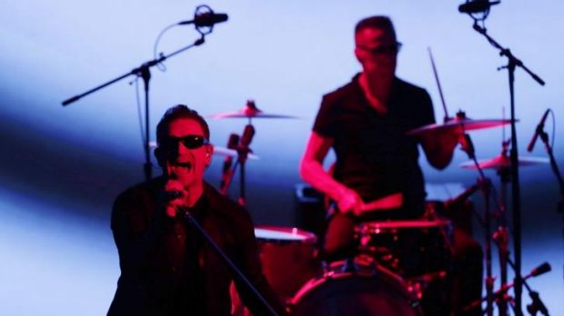 U2 members Bono, left, and Larry Mullen Jr perform during an announcement of new products by Apple on Tuesday in ...