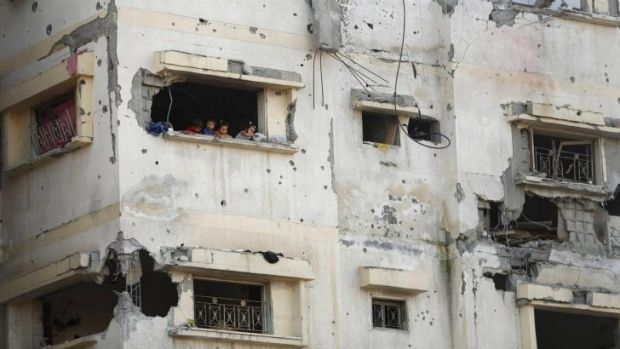Palestinian children look out of their house in the east of Gaza City.