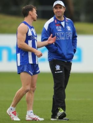 Brad Scott  with Brent Harvey at training last month.