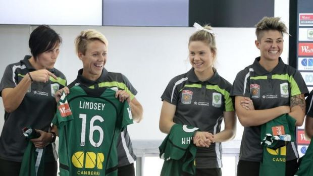 Canberra United players Holly Houston, left, hams it up next to Lori Lindsey, 2nd from left, during the Canberra United ...