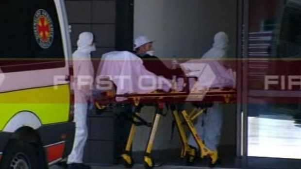 A man suspected of suffering from Ebloa is rushed into the Gold Coast University Hospital.