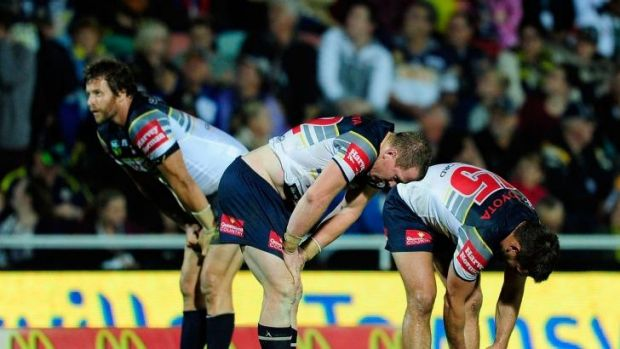 Cowboys players dejected after defeat.