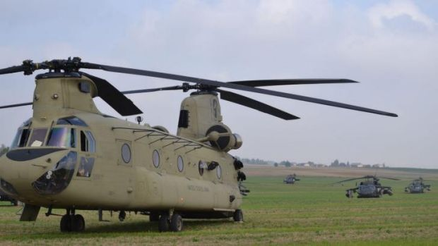 US helicopters wait on a  field in the village of Gruta, in northern Poland.
