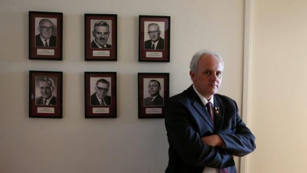 Democratic Labour Party MP no more: Senator John Madigan with portraits of former DLP politicians in his office.