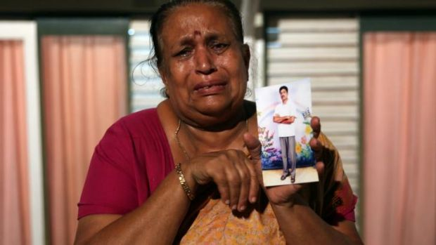 Tangaraja Rajeshwari with a photo of her son who disappeared during the final stage of the Sri Lankan civil war.