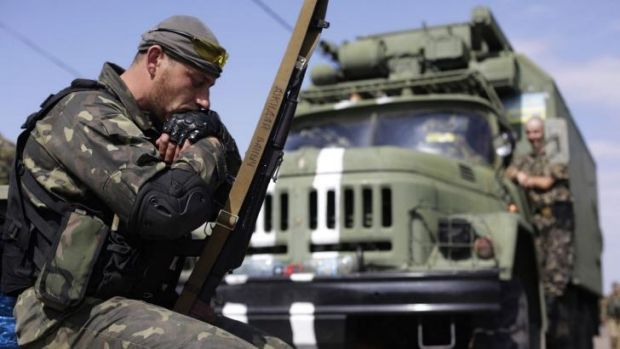 Ukrainian soldiers rest as their unit stays in the small eastern Ukrainian city of Volnovakha, in the Donetsk region.