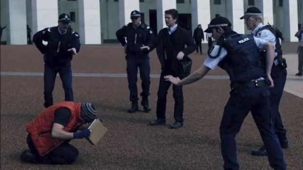 Police guarding Parliament House confront brothers played by Ashley Zukerman and Dan Spielman in the ABC political drama ...