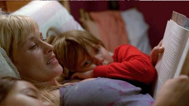 Let the growth begin... Single-mum Olivia (Patricia Arquette) reads a story to her son Mason (Ellar Coltrane) and ...