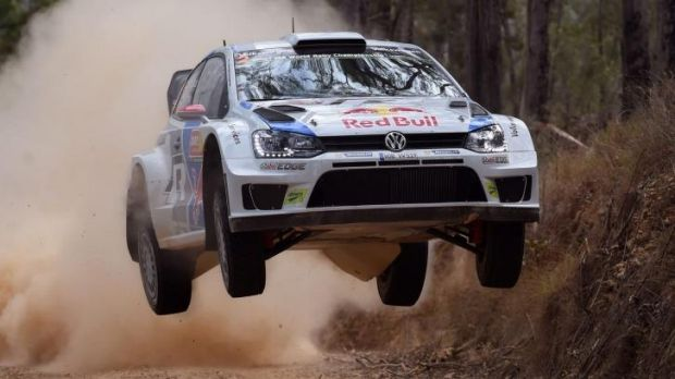 Finland's Jari-Matti Latvala guides his Volkswagen Polo over a brow.