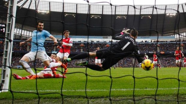 Manchester City's Alvaro Negredo scores past Arsenal's Wojciech Szczesny last December.