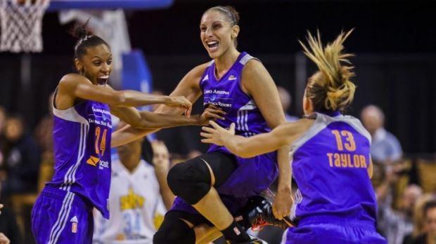 Time to celebrate: (left to right) Phoenix Mercury's DeWanna Bonner, Diana Taurasi and Australia's Penny Taylor.