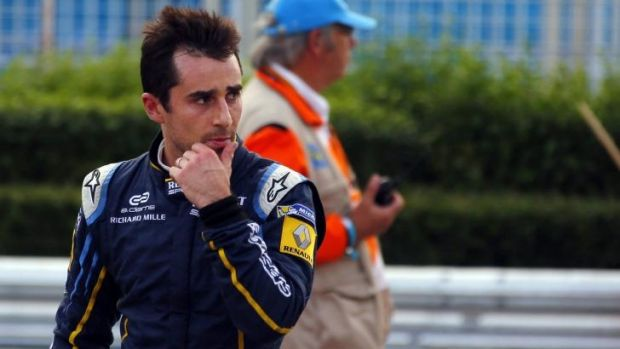 Nicolas Prost walks to the pits after his crash in Beijing.