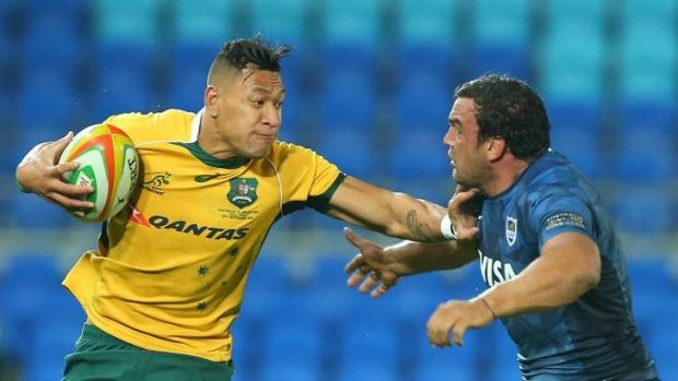 Israel Folau keeps the Argentinian defence at arm's length.