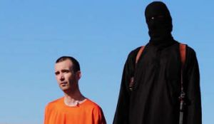 A video purportedly showing threats being made to a man Islamic State (IS) named as David Haines.