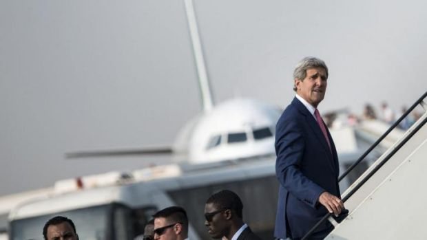 US Secretary of State John Kerry boards his plane at Cairo International Airport after talks with Egyptian President ...