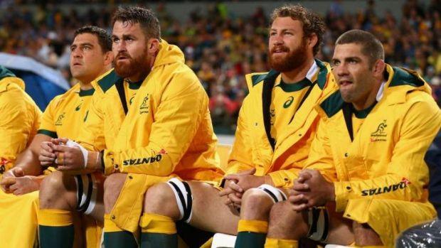 Josh Mann-Rea, far left, on the Wallabies bench on Saturday night in Perth.