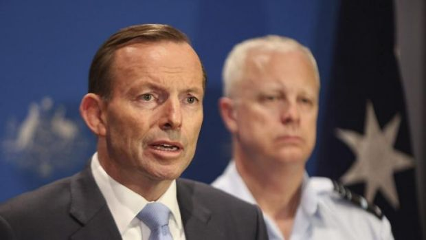 Tony Abbott speaks of Australia's military plans with the Chief of Defence, Air Chief Marshal Mark Binskin, in Darwin on ...