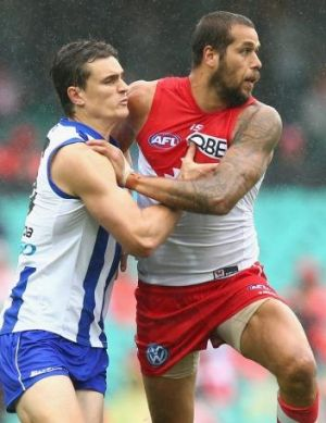 In the action: Scott Thompson competes for the ball against Lance Franklin.