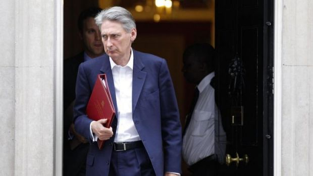 Britain's Foreign Secretary Philip Hammond leaves 10 Downing Street following a meeting of the emergency response committee.