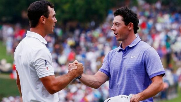 The money man: Billy Horschel shakes hands with Rory McIlroy after winning both the Tour Championship and the FedEx Cup ...