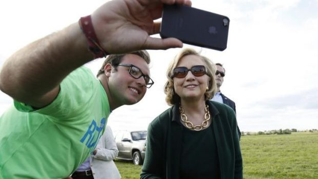 Selfie time with a fan: Mrs Clinton with a supporter at the Harkin steak fry in Iowa.