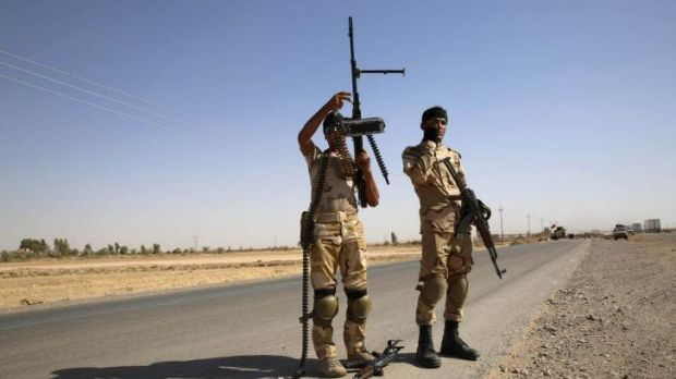 Fighters from the Shi'ite Badr Brigade militia set up a mobile checkpoint in Suleiman Beg, northern Iraq.