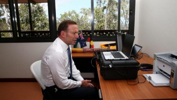Prime Minister Tony Abbott speaks with ASIO Director-General Duncan Lewis via a secure tele-conference from Arnhem Land.