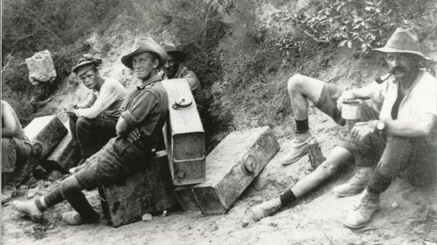 Men of the 6th Field Battery on water-carrying fatigues stop for a rest and a smoke.