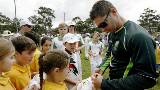 Michael Clarke signs autographs for children at the Kotara South Public School in Kotara, a suburb of Newcastle, on Monday.