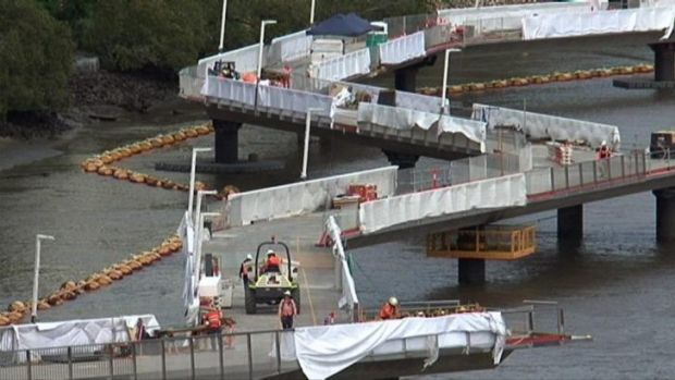 A contractual dispute threatens to derail the reopening of Brisbane's Riverwalk this Sunday.