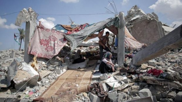 Palestinians shelter amid the rubble of their destroyed house in the town of Khan Younis in the southern Gaza Strip.