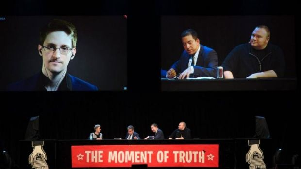 NSA whistleblower Edward Snowden (left) speaks via video link to an Internet Party event in Auckland on Monday.