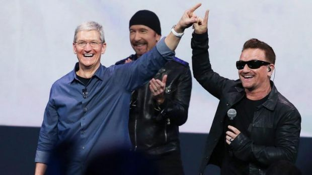 Apple CEO Tim Cook and U2 singer Bono.