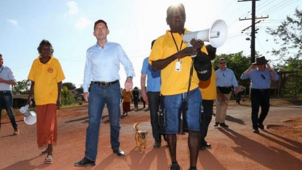 Prime Minister Tony Abbott joins school attendance officers on the walking bus in Yirrkala during his visit to North ...
