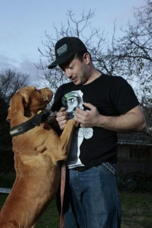 Justen Storay from Griffith plays with his dog Laps in his backyard.