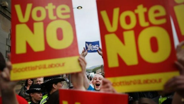 Yes campaigners stand near No supporters at Dumbarton Town Hall as former prime minister Gordon Brown leaves after ...