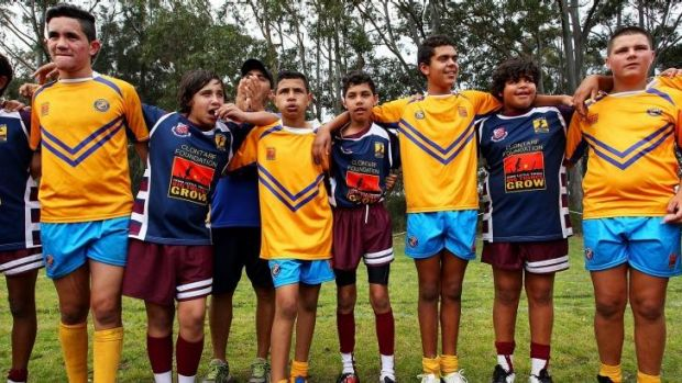 Congratulations: Players from Armidale and Moree unite following a match during the Clontarf Rugby League Festival.
