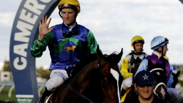 Blake Shinn and Hooked in the winner's circle at Broadmeadow racecourse on Wednesday.