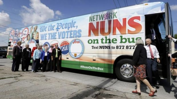 Vice-President Joe Biden steps off the Nuns on the Bus tour bus during a stop in Des Moines, Iowa.