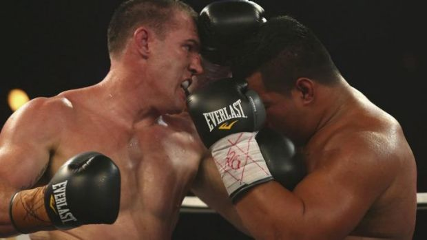Paul Gallen trades punches with Herman Purcell.