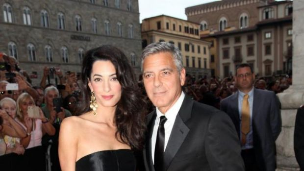 The couple stayed close during their first public outing in Italy, ahead of their wedding in the coming days.