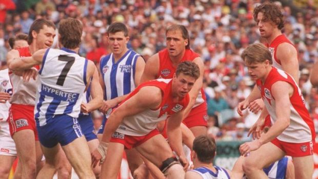 The Swans and Kangaroos battle out the 1996 grand final.